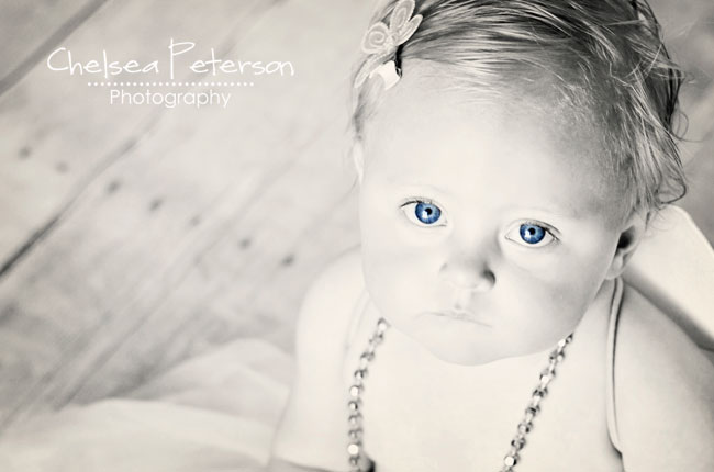 little girl black and white with blue eyes