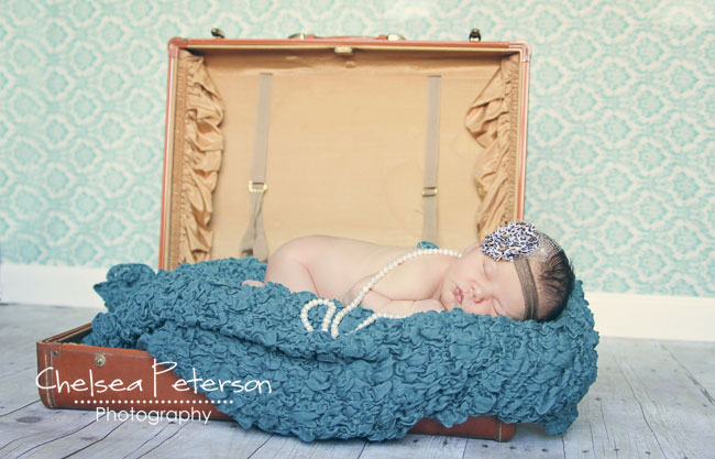 newborn in suitcase