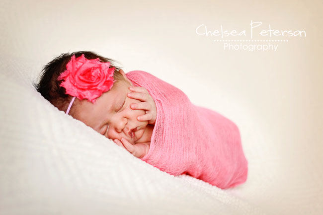 newborn in pink wrap
